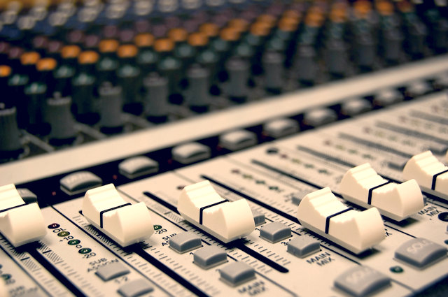 Jingle competition mixing desk image by Kristin Smith (via Shutterstock).